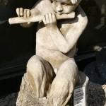 Mythical Fawn on Log